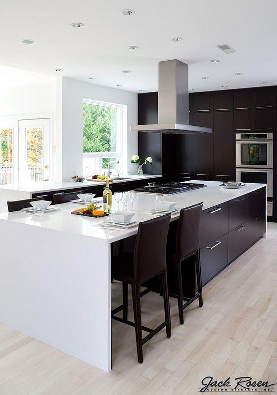 monochrome kitchen reflecting handles