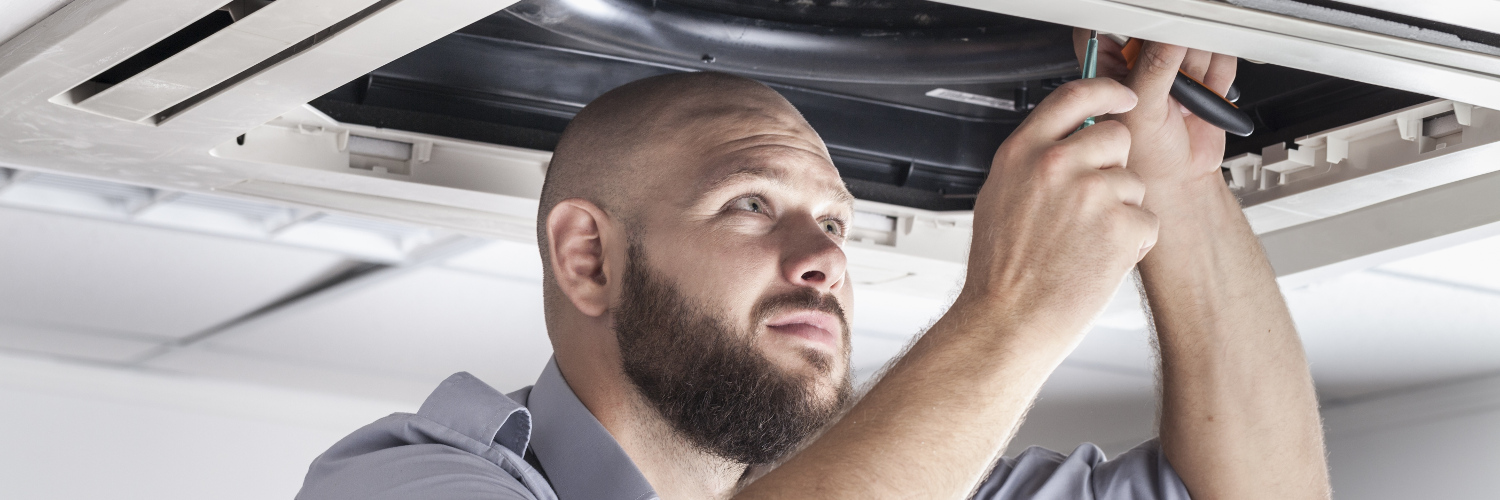 Engineer performs an air conditioning service